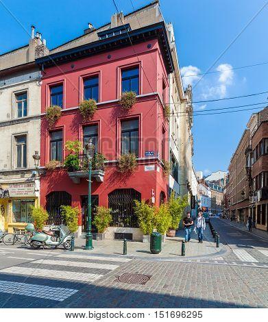 Brussels, Belgium - April 5, 2008:  Tourists Walk Along Rue Du Midi With Vintage Homes