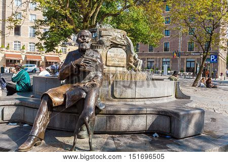 Brussels, Belgium - April 5, 2008: Tourists Seating Near Charles Buls Fountain