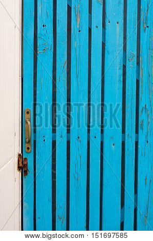 wicket door with a handle made of boards turquoise