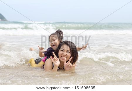 Mum And Children Play On Sea
