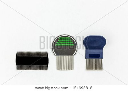 Three different kinds of lice combs. Studio shot on white background with copy space.