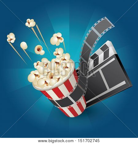pop corn with film strip and movie clapper