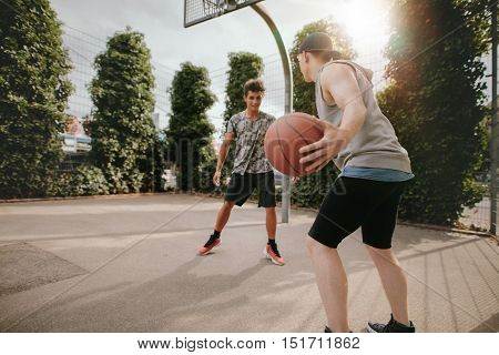 Young Friends Playing Basketball On Court