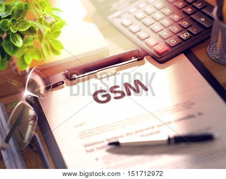 Business Concept - GSM on Clipboard. Composition with Clipboard and Office Supplies on Office Desk. 3d Rendering. Blurred and Toned Illustration.