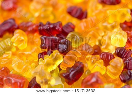 Heap of Gummy Bears (close-up shot; selective focus) for use as background image or as texture