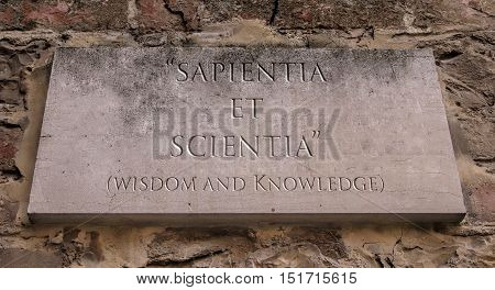 Sapientia Et Scientia. A Latin phrase meaning Wisdom and Knowledge. Caldwell College  motto. Engraved text.