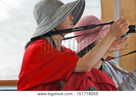 LAGO MAGGIORE ITALY - SEPTEMBER 19: Every foreign tourists are always getting ready to shoot Lago Maggiore Italy on September 19 2016
