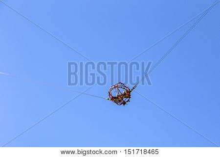 People fly up on catapult, amusement park rides