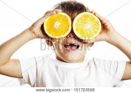 little cute boy with orange fruit double isolated on white smiling without front teeth adorable kid cheerful close up