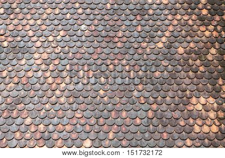 Old red brick roof tiles background. texture