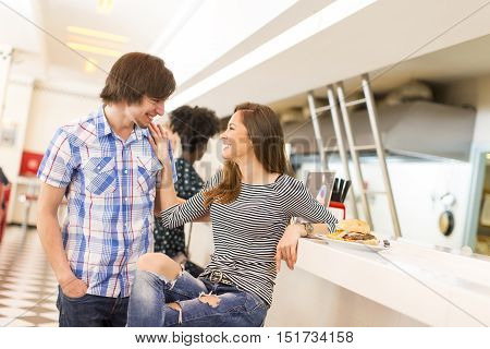 View of the young couple eating in the diner