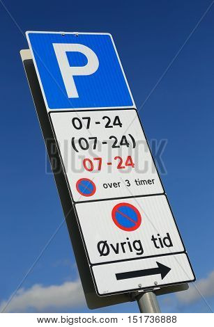 Parking Rules at a parking lot in Norway signposted with road sign and additional panel. Parking allowed all days from 7 am to 24 pm limited to three consecutive hours.