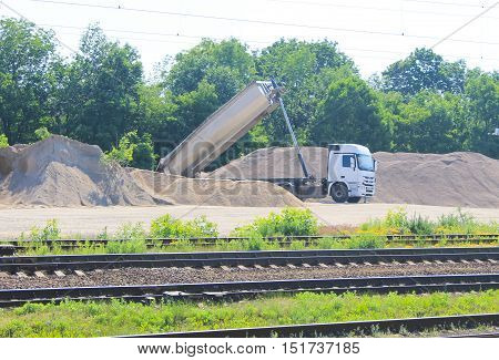 Tipper truck unload gravel. Truck at work