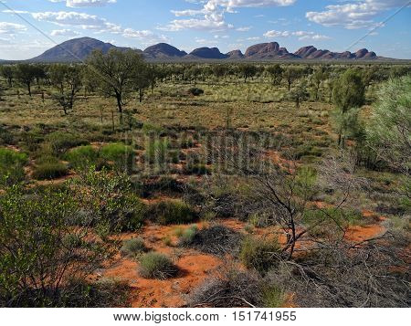 View of the Olgas, also known as Kata Tjuta, and the plain in the Northern Territory in Australia. Consisting of 36 shale domes, Olga Mountains are located to 365 km southwest of Alice Springs.