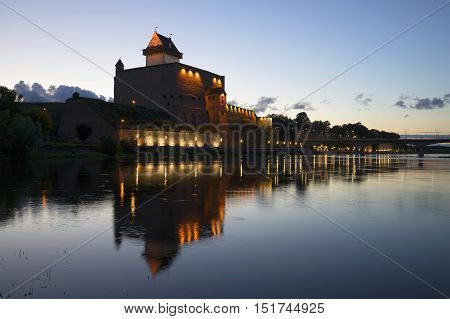 Herman's castle and the waterfront on a summer night. Narva, Estonia