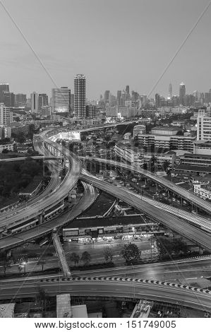 Black and White, Aerial view twilight sky over city downtown background, highway interchanged, long exposure