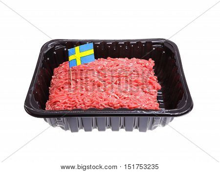 One pack of ground beef decorated with a Swedish flag as an origin label isolated on white background.