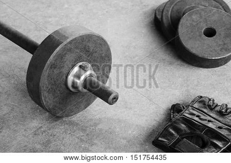 Weight iron barbell bar dumbbell on a sport gym