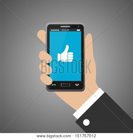 Hand holding smartphone with like icon on gray background