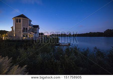 Beautiful night sky astrophotography landscape image of stars over still lake