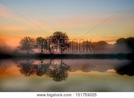 Stunning Vibrant Autumn Foggy Sunrise English Countryside Landscape Image