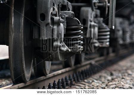 wheel of railway car on rails closeup