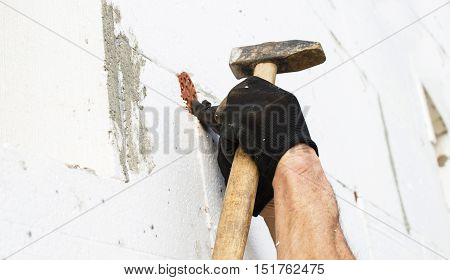 The Process Of Fixing The Dowel-umbrella With A Hammer