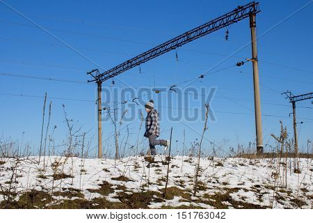 small boy walking near the railway line electrocution winter