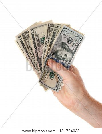 One human hand holding assorted US dollar bills like a fan isolated on white background.