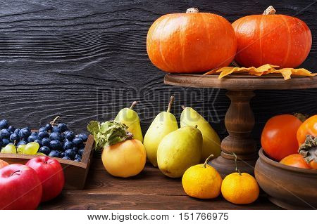 Still life with pumpkin and autumn fruit in rustic style with copy space