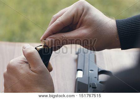 Loading A Magazine. Loading Gun. Handgun Magazine,