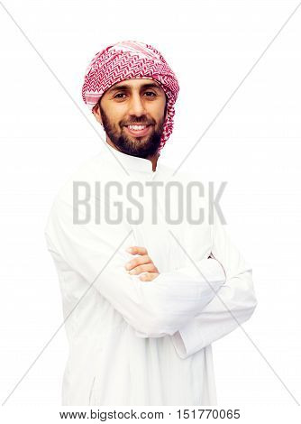 Young smiling handsome arabic man wearing traditional clothes isolated on white