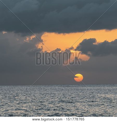 Tobago sunset square composition dusk time cloudy sky tropical