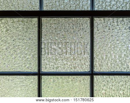 Horizontal, closeup image of textured window panes