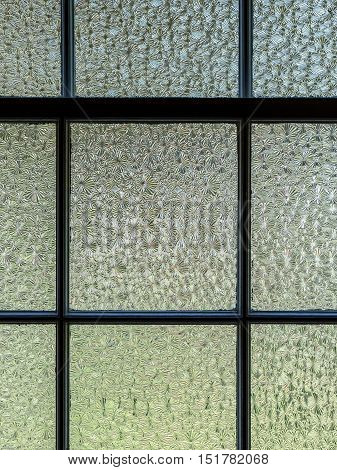Vertical, closeup image of textured window panes