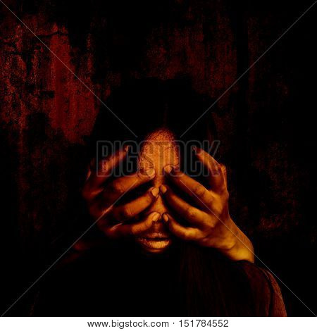 Hands of person on scary woman face,Horror background for halloween concept and book cover ideas