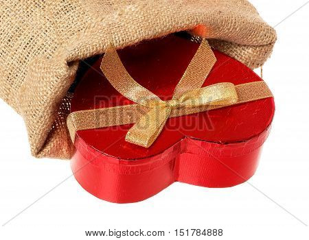 A sac containing a hert shaped gift box isolated on white background.