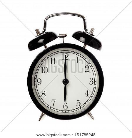 Back alarm clock with analog display six o clock isolated on white.