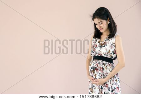 Young Pregnant Model Standing And Her Belly. Future Mom Expecting Baby.