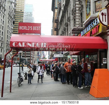NEW YORK - OCTOBER 13, 2016: Long line at the famous Carnegie Deli in Midtown Manhattan. It was opened in 1937 adjacent to Carnegie Hall. It is going to close on December 31, 2016.