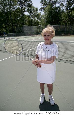 Senior Lady Plays Tennis