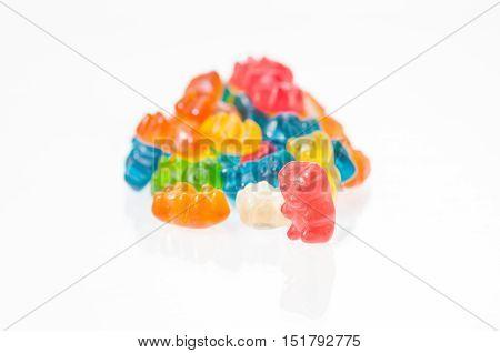 Red gummy bear still standing over white background