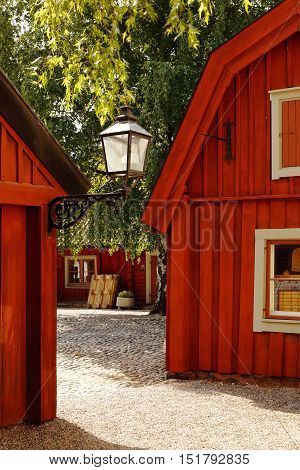 Old red wooden 1700th century smithy buildings in Eskilstuna Sweden.