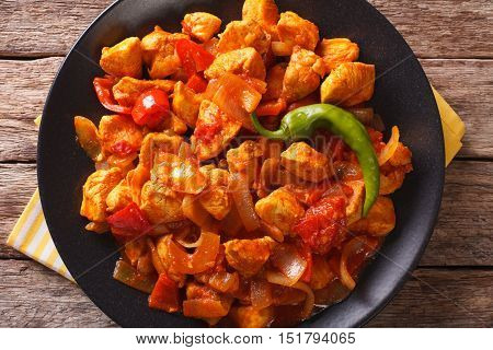 Spicy Chicken Jalfrezi With Pepper And Onion Close-up. Horizontal Top View