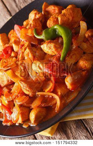 Indian Cuisine: Chicken Jalfrezi Close-up On A Plate. Vertical