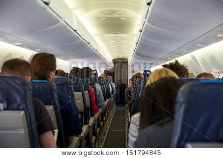 Many people inside plane seen from the back of the plane