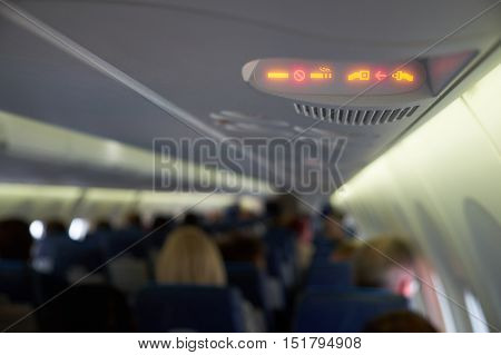 Fasten seat belts and no smoking signs on inside plane