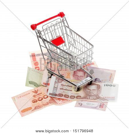 Shopping cart on assorted denomination of the Thai currency baht isolated on white.