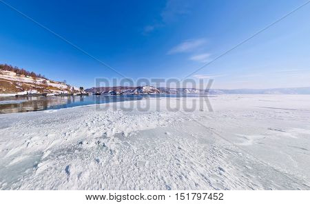 The Snow On The Ice Lake Baikal At The Pier From Which The Ship Sails In Listvyanka, The Angara Rive