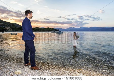 Young Married Couple On A Seacoast Promenade